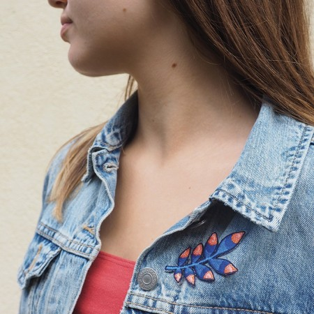 Embroidered iron-on patch with Blue Tropic pattern