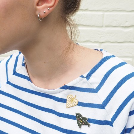 Embroidered iron-on patch with Kaki Bird pattern